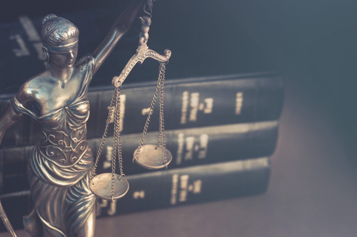 Statue of Lady Justice and legal books