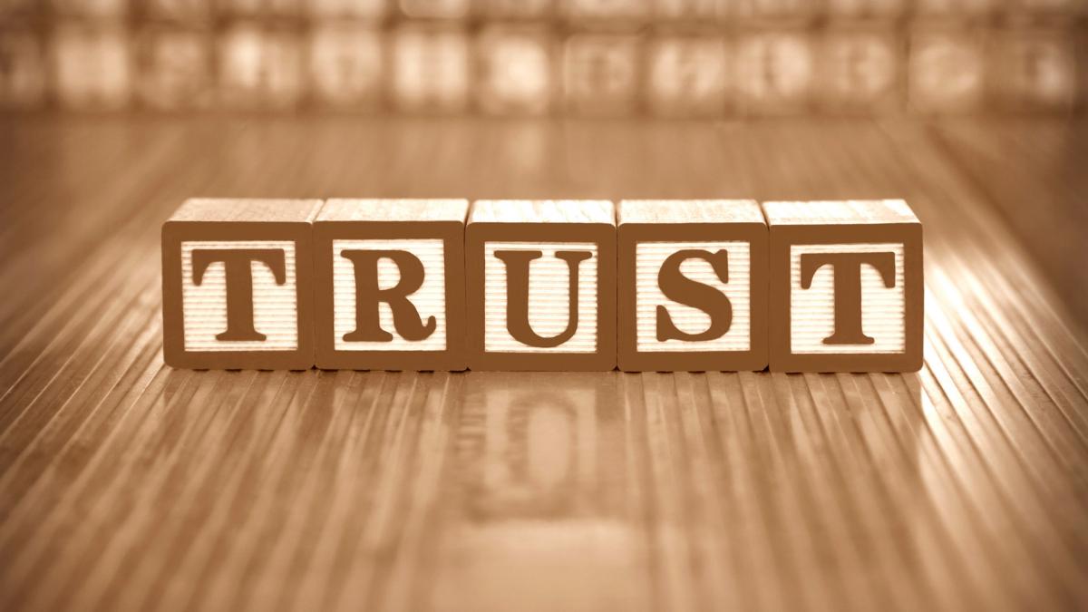 "Children's blocks spelling the word ""Trust"""